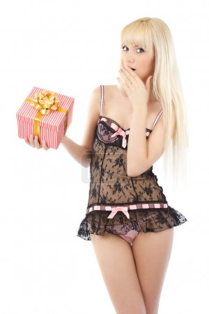 Beautiful young girl in sexy pink lingerie with gift box
