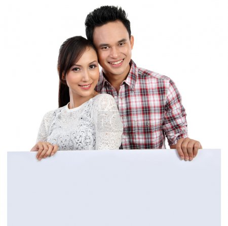 Couple holding blank banner on white