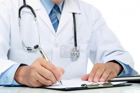 Photo pour Gesture of medical doctor's hand writing a note - image libre de droit