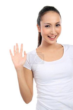 Photo pour Belle jeune femme dire bonjour isolé sur fond blanc - image libre de droit