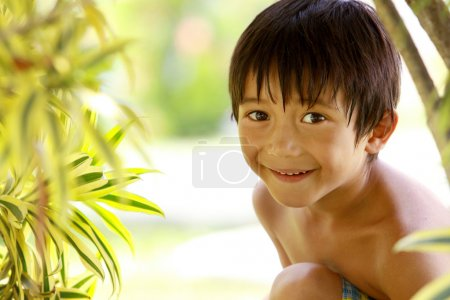 Boy sitting in the park