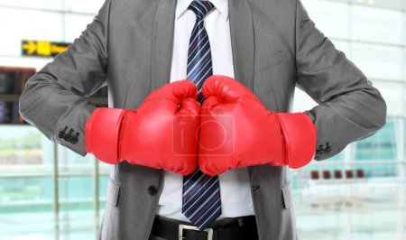 Photo for Businessman with boxing glove ready to fight - Royalty Free Image