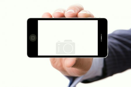 Hand holding smartphone with a blank screen