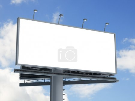 Billboard against blue cloudy sky