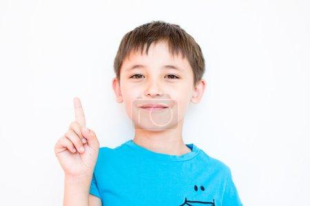 The boy raised his index finger