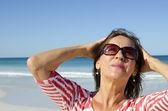 Portrait Mature joyful healthy woman at beach