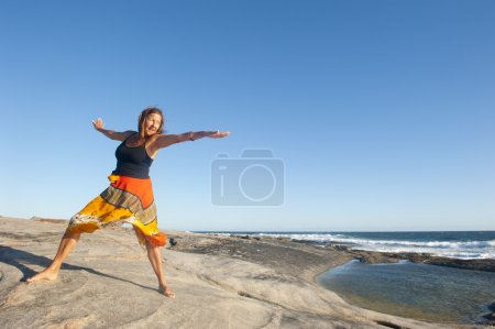 Happy, joyful, confident woman at ocean