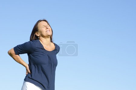 Mature woman suffering from back pain