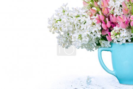 Wildflowers in a light blue cup