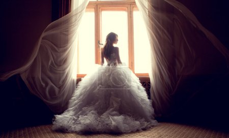 Photo for Portrait of the beautiful bride against a window indoors - Royalty Free Image