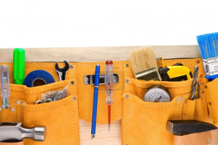 Tools in leathern belt isolated on white