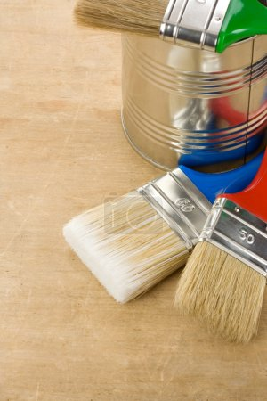 Paintbrush and can on wood