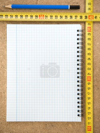 Notebook and tape measure