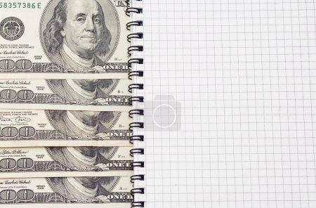 Dollars and binder checked pad
