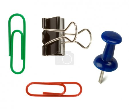 Pushpin and paper clip isolated on white