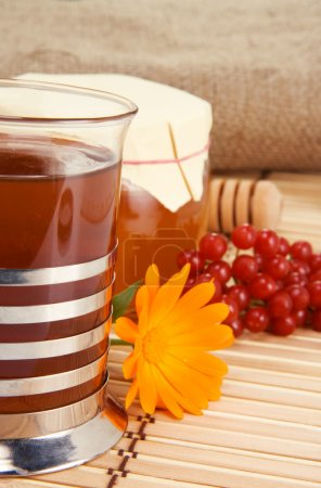 Tea with flower, honey, viburnum and sack