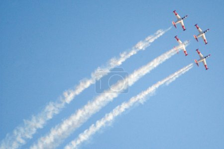 Four Fouga Magister planes are displaying their ac...