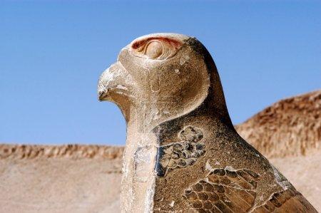 Carved bird statue with hieroglyphics outside Edfu...