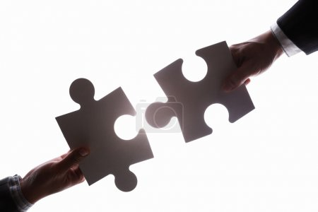 Business connecting two jigzaw puzzle pieces