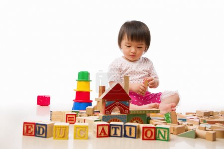 Photo for Asian female toddler playing on the floor alone - Royalty Free Image