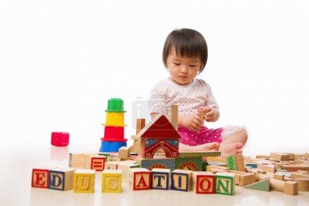 Asian female toddler playing