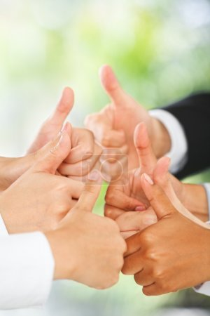 Photo for Raise thumbs to each other with green environment background - Royalty Free Image