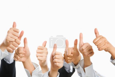 Photo for Raise their thumb up above over the white background - Royalty Free Image