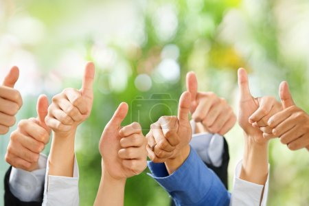 Thumbs up on green background