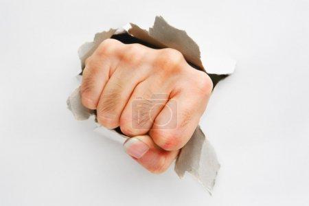 Fist breakthrough white wall