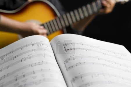 playing guitar with musical chords