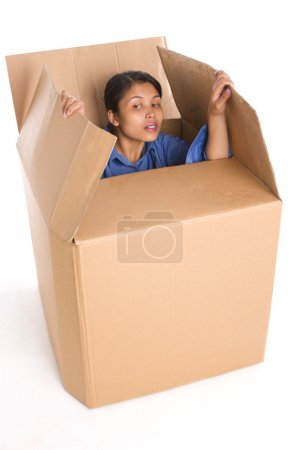 Photo for A young woman is curiously looking outside the box. - Royalty Free Image