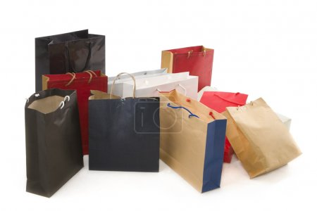 Photo pour Les sacs en papier disposés sur le sol sur fond blanc . - image libre de droit