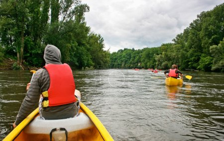 Photo for Tourists kayaking on river Dordogne in Southern France. - Royalty Free Image