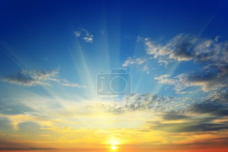 Photo for The sun rays illuminate the sky above the horizon - Royalty Free Image