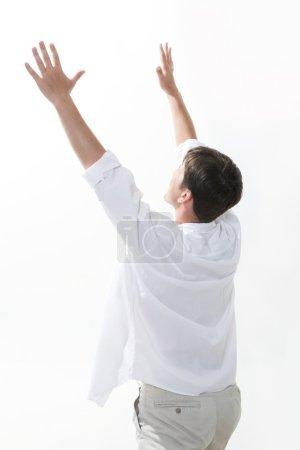 Happy man lifting up hands