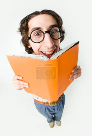 Photo for Portrait of smiling male in glasses reading interesting book - Royalty Free Image