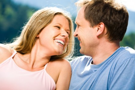 Photo for Close-up of joyful woman laughing while looking at smiling man - Royalty Free Image