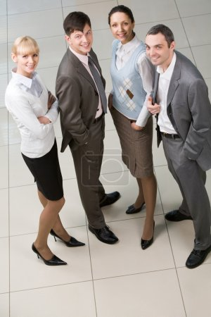 Photo for Portrait of confident business group standing in row and looking at camera - Royalty Free Image
