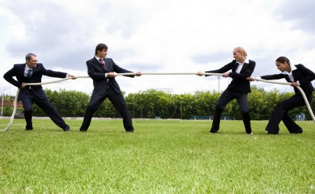 Photo for Photo of business stretching the rope in the stadium - Royalty Free Image