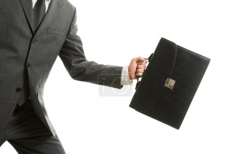 Photo for Close-up of businessman with briefcase in hand isolated on white background - Royalty Free Image