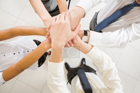 Photo for Image of business hands on top of each other symbolizing support and power - Royalty Free Image