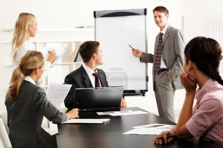 Photo for Image of smart business looking at their leader while he explaining something on whiteboard during seminar - Royalty Free Image