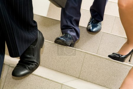 Photo for Image of female and male legs going downstairs - Royalty Free Image