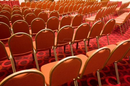 Photo for Back view of several rows of red armchairs in conference hall - Royalty Free Image