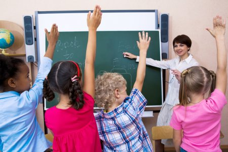 Photo for Image of pupils stretching their hands during the lesson - Royalty Free Image