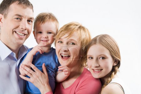 Photo for Portrait of joyful parents with their cute children looking at camera and smiling - Royalty Free Image