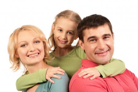 Photo for Portrait of happy parents being embraced by their daughter - Royalty Free Image