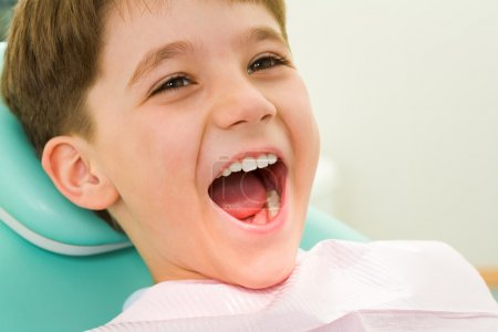 Youngster with his mouth wide open during checkup at the dentist's