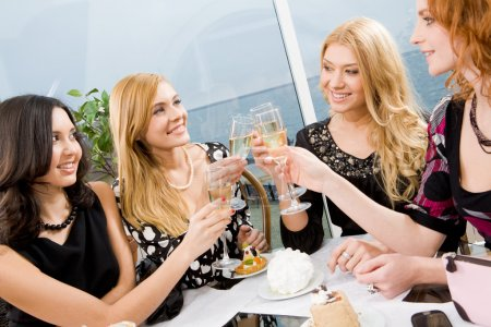 Photo for Portrait of elegantly ladies with champagne touching their glasses - Royalty Free Image