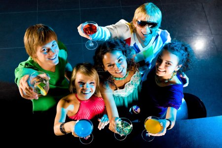 Photo for Above angle of happy friends cheering up at party - Royalty Free Image